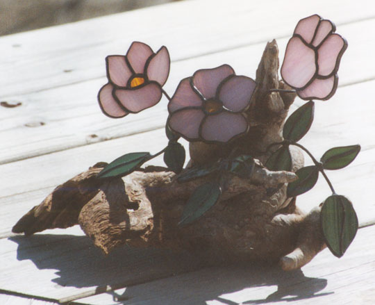 Beach roses on driftwood