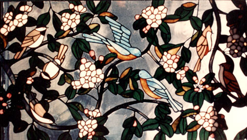 Song birds with apple blossoms